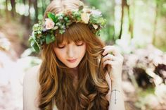 wildflower-inspired floral crown....btw how pretty is her hair?