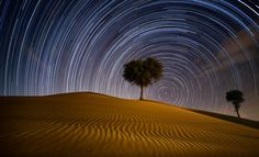 A long exposure was used to create this wicked star path formation in the UAE Dubai desert. Each of the combined 350 shots lasted for about 30 seconds with roughly 3 hours of just shooting [2048x1243] Photo by Rezaul Haque