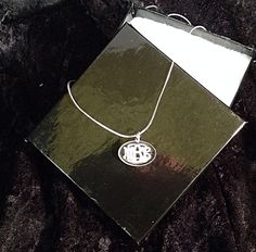 """Clearly a Monogram Necklace - )$19.95) your monogram engraved into the back side of a cast acrylic oval - approx 1"""". Silver plated chain. To order email engrave9@gmail.com. Follow us on Instagram and Facebook. Engravings Unlimited Great teacher or bridesmaid gift."""