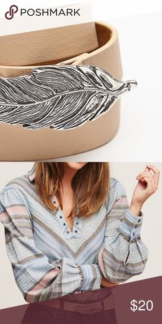 FREE PEOPLE~Silvertone Feather Buckle Fashion Belt New never worn..appears to be vegan, but could possibly be a layer of leather on top attached to the other material. Nice regardless.. just don't want to guarantee either way. Anthropologie Accessories Belts