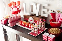 "Buy cardboard letters from the craft store, spray paint white and make the perfect ""LOVE"" centerpiece! #valentinesday"
