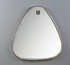 Interlude Bella Mirror. With a thin metal frame and faux wall hook detailing, the classic oval shape of the Bella Oval Mirror gets a unique and special twist.  This rounded corner triangle mirror delivers a midcentury feel and dazzles with its thin metal frame and faux wall hook detailing – Modish Store