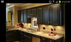 Black Cabinets, Yellow Wall Kitchen