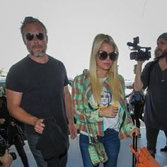 Jessica Simpson and husband Eric Johnson spotted at LAX International Airport