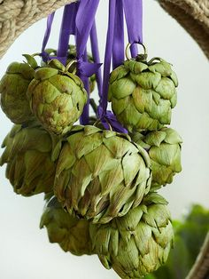 Skip this green at the dinner table and use it as swag for a mirror or banister instead: http://www.bhg.com/decorating/seasonal/fall/natural-fabulous-fall-decor/?socsrc=bhgpin100714artichokeswag&page=8