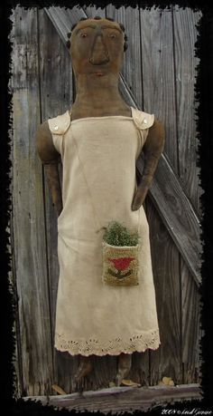 A very Primitive Black doll with Hooked purse  I think all of my dolls should have these purses