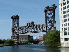 Canal Street Railroad Bridge, a vertical lift bridge built in 1915 and still in use 100 years later (Chicago Pin of the Day, 3/11/2015).