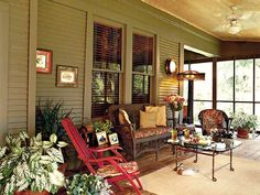 The porch is the hub of life at this house on Lake Bistineau, near Shreveport. The mix of antiques and junk-store finds creates a comfortable atmosphere. (Photo: Photo: Laurey W. Glenn)