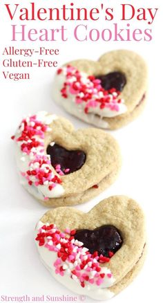 Gluten-Free Valentine's Day Heart Cookies (Vegan, Allergy-Free) | Strength and Sunshine | A fun decorated heart-shaped cookie recipe for Valentine's! These Gluten-Free Valentine's Day Heart Cookies are vegan and allergy-free so everyone can enjoy! These delicious raspberry Linzer cookies are made from cut-out sugar cookie dough, raspberry jam, and decorated with dairy-free white chocolate and sprinkles! #valentinesday #cookies #sandwichcookies #sugarcookies #linzercookies
