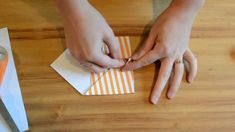A tutorial on how to fold an envelope from NellieBellie. For more crafting ideas and tutorials, head over to www.nelliebellie.com