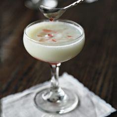 Last-Word Fizz      .75 oz Gin     .75 oz Green Chartreuse     .5 oz Luxardo Maraschino Liqueur     .75 oz Fresh lime juice     1 tbsp Powdered sugar     1 Egg white     Club soda     1 tsp Cherry juice  Garnish: Lime twist