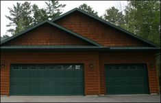 Green garage doors are great for mountainess terrain. Hunter green is a very popular shade of Green to use. Garage Door Colors, Garage Doors, Garage Door Makeover, Raised Panel, Garage Plans, Steel Doors, Hunter Green, Shades Of Green, Exterior