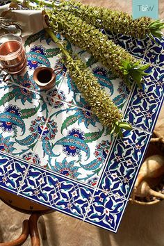 Tile your own table, with stylist Emmaly Stewart. Easy instructions for creating a tabletop with beautiful patterned Turkish tiles.