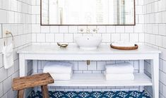 Let's call OPTION C 'Halcyon-esque' [ ala @_halcyonhouse OBVS ] • Its kind of a mix of A and B - Earthy but still minimal. Bright with masses of white tile + timber with pops of blue, brass + wood.  #homeliving #homedecor #houseandhome #interiordesign #interiorstyling #homeinspo #houseinspo #coastalhome #coastalstyle #beachhouse #beachstyle #halcyonhouse #interiorinspiration #interiordetails #navyandwhite #bathroom #bathroomdesign #bathroomdecor #jantanatiles #whiteonwhite #brass