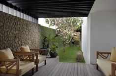 The terraces behind the master suite and bunk bedroom serve as private corners for quiet retrea