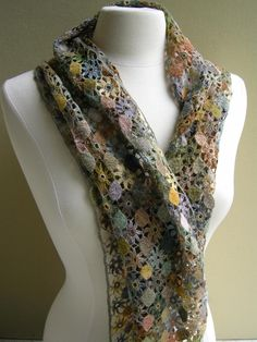 This Fleur Simple scarf is hand crocheted in a pattern of alternating medaillons and small flowers