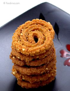 This Chakli Recipe Explains How To Make Chakli from Whole Wheat Flour With Step by Step Photos and Provides Tips To Make Them Crisp yet Melt In Mouth With Perfect Spiral Shape. Indian Sweets, Indian Snacks, Indian Food Recipes, Diwali Snacks, Diwali Food, Diwali Dishes, Diwali Recipes, Dry Snacks, Healthy Snacks
