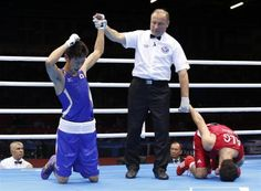 Japan's Satoshi Shimizu (L) reacts as he defeats Algeria's Mohamed Amine Oudahi during their Men's Bantam (56kg) Quarterfinal boxing match during the London 2012 Olympic Games August 5, 2012.   REUTERS/Murad Sezer