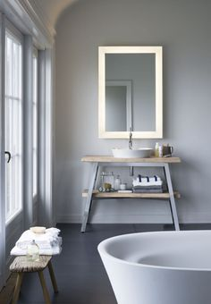 Minimalistic bathroom with a Nordic inspired decoration and a mirror with LED-light.