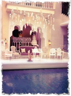 Truly romantic shabby chic stage for the bride & groom on top of the pool!
