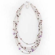 Multiple strands of of beautiful jewel-toned beads accented with shimmering silver creates a lovely layered look without any of the fuss, making this unique necklace an essential part of your eclectic bohemian look!
