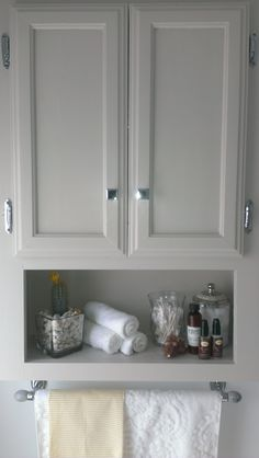 over the toilet storage, chrome knobs from restoration hardware, monogrammed towel, marble stone and chrome towel rack, martha stewart sharkey gray cabinet