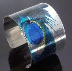 Silver peacock feather cuff bracelet