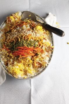 Shirin Polow (Iranian Rice Pilaf) by Saveur. This rice pilaf is famed for its thick, crisp tah dig crust and crown of sweet garnishes. Rice Recipes, Indian Food Recipes, Vegetarian Recipes, Cooking Recipes, Ethnic Recipes, Easy Recipes, Dessert Recipes, Rice Pilaf Recipe, Iranian Food