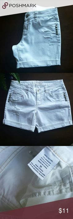 White Denim Distressed Jean Shorts White denim jean shorts w/stud detail on front and back pockets. Distressed look. Cuffs are rolled and sewn.These are junior, size 11. Fun and Edgy look!! 99% cotton 1% spandex BONGO Shorts Jean Shorts
