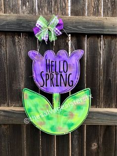 Our tulip is laser-cut from 1/4 birch. Measures 19x16. Colors can be changed! The attached wire hanger adds a few inches to the overall height. All of our door hangers are clear-coat to highlight the natural accents left from the laser-cut. Your spring door hanger will have