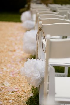 I love these pompoms!! could do every second chair with these and inbetween could have baby's breath pompoms...hmmm
