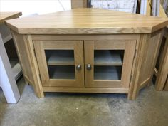 Solid oak corner TV unit. Cobwebs Furniture Company.