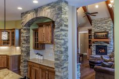 Love how the rock in the Kitchen matches the fireplace rock in the Living Room.