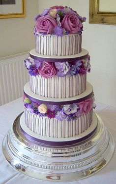 Classy Purple and Lilac Striped Wedding Cake by handmadebyhannah, via Flickr