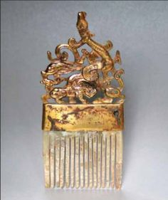 WESTERN HAN DYNASTY (206 B.C.-A.D. 9). Gilded bronze comb with jade teeth section W:12cm