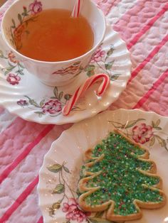 Christmas Tea with a Christmas Cookie...pretty pattern on the tea cup and plate