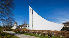 link architects designs heaven-reaching ålgård church in norway