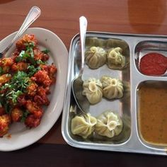 Photo of Himalayan Range Nepali Restaurant - Cary, NC, United States. My lunch spread of Chicken Momos and Gobi Manchurian...I can't eat here without getting that or Chili Chicken
