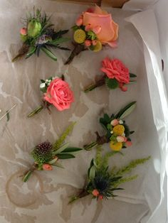 Rustic miss-match buttonholes with a touch of coral, peach and pink finished with twine