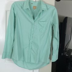 Mint long sleeve button up shirt This shirt is very comfortable and versatile! Front measures 25 inches in length, back measures 29 inches in length. Only flaw is a red dot on the inside (third photo) but it doesn't show through to the other side. Last photo is some style inspiration  Guess Tops Button Down Shirts