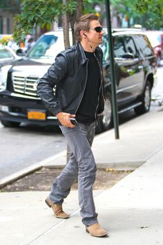 Jeremy Renner and that black leather jacket and the gray pants of death