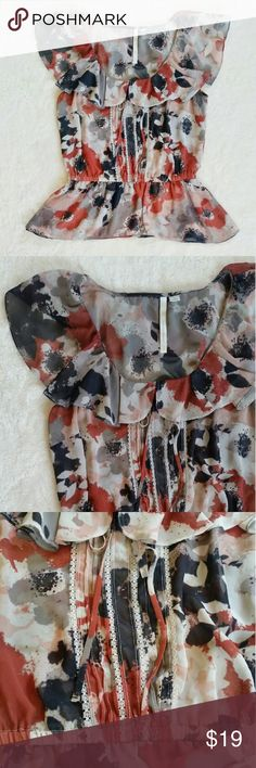 "💙Host Pick!💙 LC Silky Floral Blouse LC Lauren Conrad silky floral blouse. Semi sheer. Please check out photo 4. My hand is under thhe fabric. Size small. Pit to pit is 19"" flat and shoulder to hem is 23.5"". New without a tag. LC Lauren Conrad Tops Blouses"