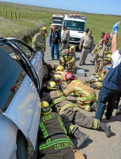 Cal Fire-Butte County, paramedics and CHP respond to the scene where Shane Mathias was trapped for two hours under his minivan after he had driven the vehicle into a ditch along Nelson Road on Saturday. Mathias was transported to Enloe by FlightCare. (Jason Halley — Enterprise-Record)