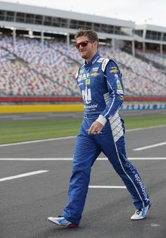 Dale Earnhardt Jr. Photos Photos - Dale Earnhardt Jr., driver of the #88 Nationwide Patriotic Chevrolet, walks on the grid during qualifying for the Monster Energy NASCAR Cup Series Coca-Cola 600 at Charlotte Motor Speedway on May 25, 2017 in Charlotte, North Carolina. - Charlotte Motor Speedway - Day 1