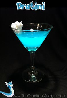"""Dratini (Pokemon cocktail)  Ingredients:11/2 oz gin (Bombay Sapphire Gin used)11/2 oz Hpnotiqsplash of blue curacao  Directions: For this variation of martini, mix and stir in the ingredients over ice, then strain into a chilled cocktail glass. Place a dollop of whipped cream on the side of the glass as a garnish.  """"It is called the """"Mirage Pokémon"""" because so few have seen it."""" -Pokedex entry for Dratini   Drink created and photographed by The Drunken Moogle."""