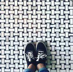 Selfeet on a textured black and white floor.   #basketweave #marble #mosaic  #sneakers