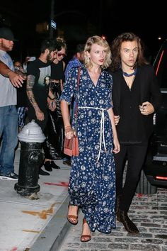 Taylor Swift wearing Tommy Hilfiger Gigi Maxi Dress, Isabel Marant Tan Leather Jaeryn Sandals and Michael Kors Eyelet Studded Leather & Suede Mini Crossbody Bag