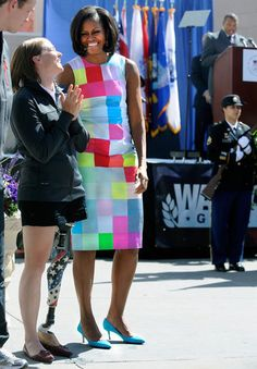 Melissa Stockwell, U.S. Army Veteran and Paralympian, and First Lady Michelle Obama share a light moment before Stockwell lit the torch for the 2012 Warrior Games. Mrs. Obama attended the opening ceremony for the Warrior Games at the Olympic Training Center in Colorado Springs.