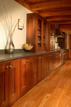 Reclaimed jarrah crafted into a buffet and kitchen cabinetry all on reclaimed Heart Pine flooring.