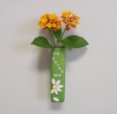 Mini polymer clay flower vase that really holds water. Could also be used as a pen holder or just a refrigerator magnet.